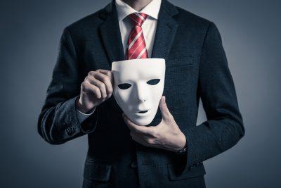 仮面とビジネスマン さくらや業者のイメージ
