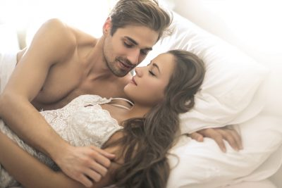 Beautiful couple in the bed